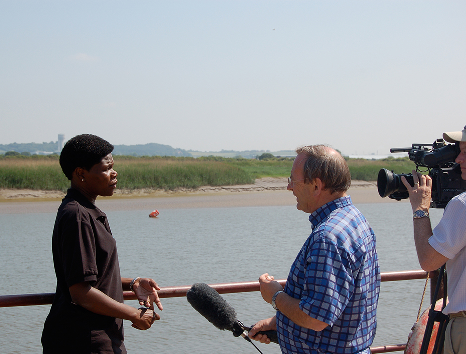 Community support coordinator Bev Mitchell being interviewed for Granada TV during The Mersey Baton Relay, June 2007.