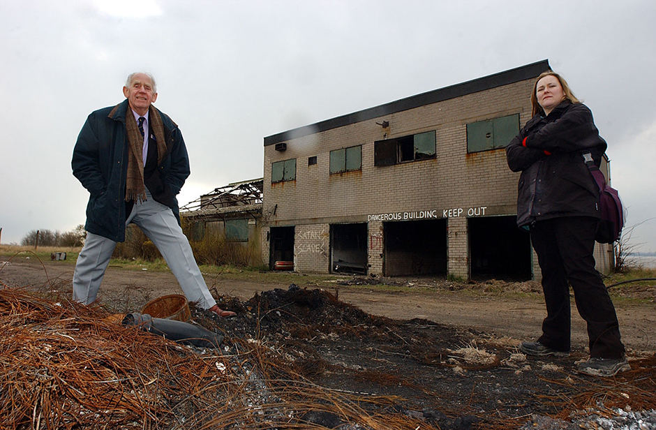 Tom Workman of Liverpool Sailing Club and Cathy Elwin of Action Mersey Estuary at the sailing club after an arson attack.